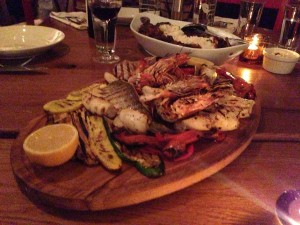 Plate of grilled seafood.