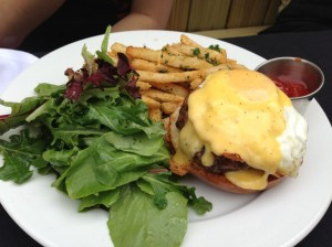 Open faced Benedict burger.